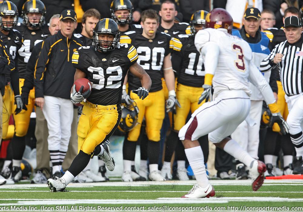 November 21, 2009: Iowa running back Adam Robinson (32) tries to allude Minnesota cornerback Kim Royston (3) during the first half of the Iowa Hawkeyes 12-0 win over the Minnesota Golden Gophers at Kinnick Stadium in Iowa City, Iowa on November 21, 2009.