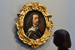 """© Licensed to London News Pictures. 06/10/2017. London, UK.   A staff member views """"Self-portrait"""", c1640, by Sir Anthony Van Dyck which has returned to the National Portrait Gallery following a three year nationwide tour and is on display alongside a new Julian Opie artwork. Photo credit : Stephen Chung/LNP"""