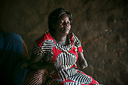Aneno Margaret, 37, a former girl soldier and sex slave, sits in her hut in Gulu. She was abducted at the age of 11 in Acholi-bur village and was assigned to a commander two years later who had 13 wives. She also started a military training at that time and spent eight years as a soldier. She gave birth to two daughters in the bush. When she was 19 years old, a mortar attack at the frontline hit her arm and the chest, resulting in the amputation of one arm. After discharged from the hospital in Uganda, she was raped by a civilian and gave birth to a daughter, and one more daughter from a new husband. She sells bananas in downtown Gulu to support herself and the children.