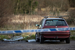 © Licensed to London News Pictures . 29/12/2018 . Wigan , UK . Police tape at the scene where they have taped off a stretch of Bickershaw Lane in Abram . GMP report they have arrested two people on suspicion of attempted murder and for conspiracy to commit attempted murder , respectively , after a 21-year-old man sustained life-threatening injuries yesterday evening (Friday 28th December 2018) . Photo credit : Joel Goodman/LNP