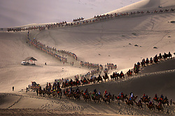 Oct. 2, 2017 - Dunhuang, China - Tourists visit the Crescent Spring and Singing Sand Dune scenic area in Dunhuang, northwest China's Gansu Province. From Oct. 1 to 8, the eight-day National Day and Mid-Autumn Festival holiday, around 710 million tourist trips will be made across China, according to predictions by China National Tourism Administration. (Credit Image: © Zhang Xiaoliang/Xinhua via ZUMA Wire)
