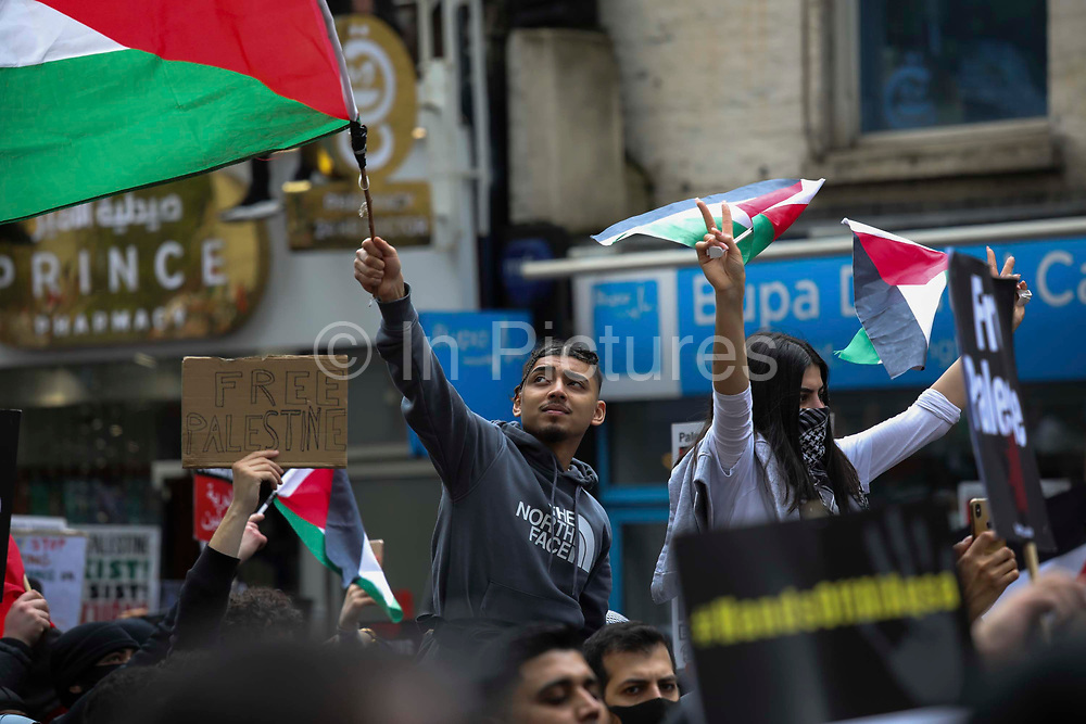 Thousands turn out in protest against the increasing use of military force by Israel and in support of Gaza on the 15th of May 2021, London, United Kingdom. The demonstration outside the Israeli embassy in Kensington High Street. The escalating war between Israel and Hamas in Gaza is increasingly costing lives and the up to 100.000 protesters were calling for Israel to stop bombing Gaza and for a free Palestine.