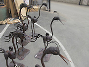 bird figurines display in a garden center