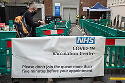 © Licensed to London News Pictures. 19/06/2021. LONDON, UK.  A man enters an NHS mass vaccination centre in Edgware Road distributing Astrazeneca vaccine doses, as the capital aims for 100,000 doses administered per day. With cases of the Delta variant increasing, the UK government has invited all over 18s for a Covid-19 vaccination in an effort to have as many people to be vaccinated by July 19th, the revised date when all lockdown restrictions are relaxed.  Photo credit: Stephen Chung/LNP