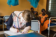 Dr Siobhan finishes up the notes of one of the patients that has just been discharged during the daily ward round. St Walburg's Hospital, Nyangao. Lindi Region, Tanzania.