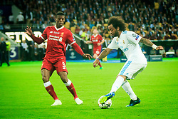 Georginio Wijnaldum of Liverpool vs Marcelo of Real Madrid during the UEFA Champions League final football match between Liverpool and Real Madrid at the Olympic Stadium in Kiev, Ukraine on May 26, 2018.Photo by Sandi Fiser / Sportida