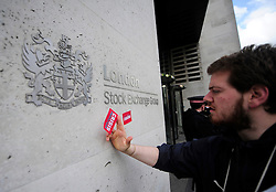 © Licensed to London News Pictures. 15/05/2012. London,Britain. Members of the Occupy London Stock Exchange group protest against against the finance industry in front of The London Stock Exchange in central London on May 15, 2012 . Photo credit : Thomas Campean/LNP