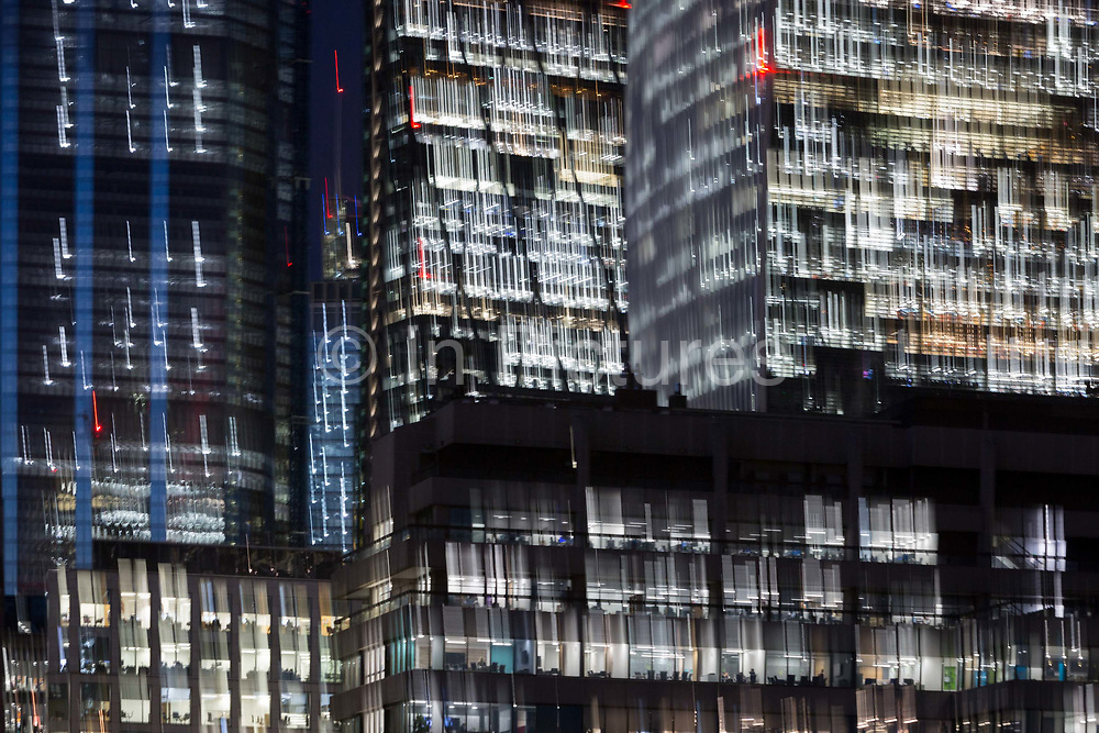 Deliberate blur and zoom on generic office buildings in the City of London - the capitals financial district aka The Square Mile, on 29th October 2018, in London, England.
