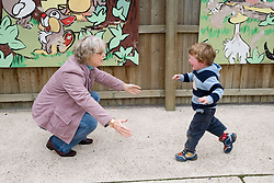Young boy running towards his grandmother,