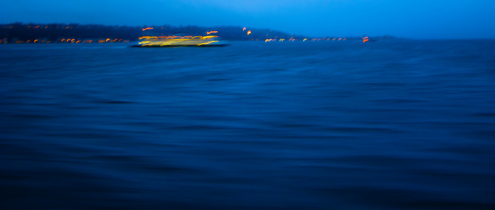 an abstract ferry proceeds across Puget Sound in late evening - Washington state DOT ferry panorama