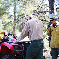 Firefighters from Acoma and other locations monitor a fire Monday in the area of Mount Taylor. The managed fire grew to more than 200 acres Tuesday.