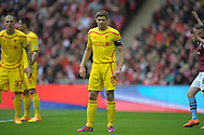 Steven Gerrard, the Liverpool captain looking on. The FA Cup, semi final match, Aston Villa v Liverpool at Wembley Stadium in London on Sunday 19th April 2015.<br /> pic by John Patrick Fletcher, Andrew Orchard sports photography.