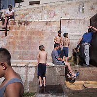 Palestinians at the spring in Battir village near Bethlehem, one of very few places in the West Bank where Israel hasn't taken control of the water source. The spring has been managed here since Roman times. <br /> <br /> The line that the Separation Barrier is following has annexed significant water sources in the West Bank.