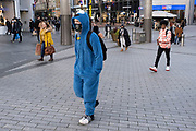 Man dressed up as a Muppet out and about visiting the shops in the City Centre as tier three / very high alert level of the Coronavirus tier system continues during the run up to Christmas on 14th December 2020 in Birmingham, United Kingdom. After 9 months of lockdown in various forms, people are used to navigating the rules of shopping safely as all non-essential shops try to increase their takings and onwards to the national economy.