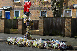Faded flowers mark the spot where Abraham Badru died on Ferncliff Road. Abraham Badru, a personal trainer, 26, was shot in the chest on 25th March in Ferncliff Road, E8. He received a National Police Bravery Award after intervening in a rape and giving evidence in court. London, April 25 2018.