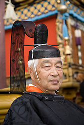 Asia, Japan, Gifu prefecture, Takayama (also known as Hida-Takayama), Shinto leader in Gonjunko Procession during Sanno Festival of Hie Jinja Shrine, held annually in April.