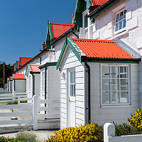 Marmont Row is a row of houses with red corrugated tin roofs in Stanley, East Falkland Island, Falkland Islands.