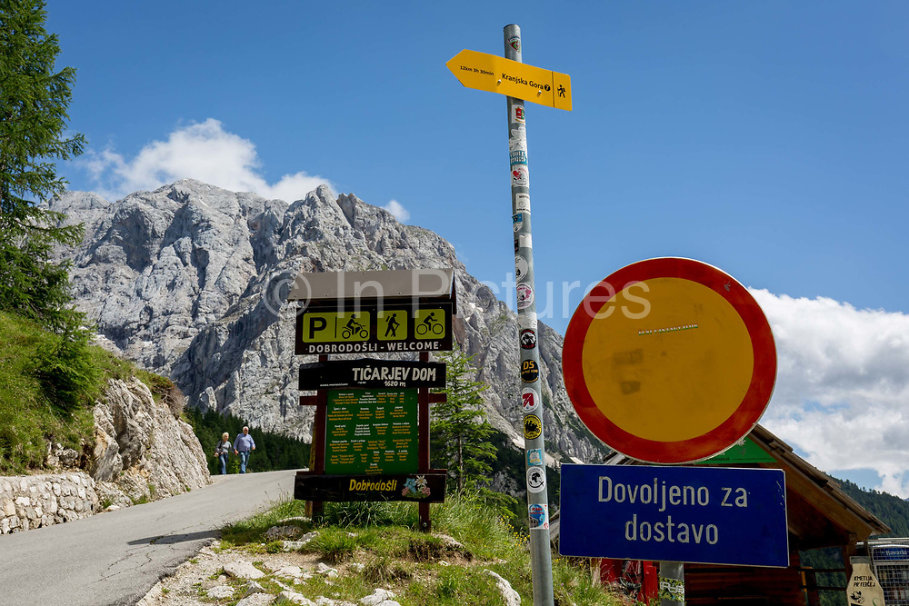 Hiking trail markers beneath the Prisank 2547m mountain view at the top of Vrsic Pass in the Slovenian Julian Alps, on 22nd June 2018, in Triglav National Park, Slovenia.