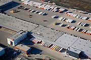 Nederland, Gelderland, Duiven, 11-02-2008; distributiecentrum van TNT (voorheen PTT Post) op het bedrijventerrein Nieuwgraaf; opleggers, trailers, distributie, logistiek, vervoer, privatisering, export, bedrijven terrein, industrieterrein, parkeerterrein, parkeren, wegvervoer, vrachtvervoer, vrachtauto, roadhub, hub, overslag, distributie, sorteren, post, vracht, pakket, PTT, depot, pakje, pakjes, logistisc, logistiek..luchtfoto (toeslag); aerial photo (additional fee required); .foto Siebe Swart / photo Siebe Swart