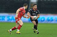 Rhys Webb of the Ospreys ® looks to get past fellow Wales scrum half Gareth Davies of the Scarlets (l). Guinness Pro12 rugby match, Ospreys v Scarlets at the Liberty Stadium in Swansea, South Wales on Saturday 26th March 2016.<br /> pic by  Andrew Orchard, Andrew Orchard sports photography.