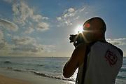 A PHOTOGRAPHER  IN THE BEACH