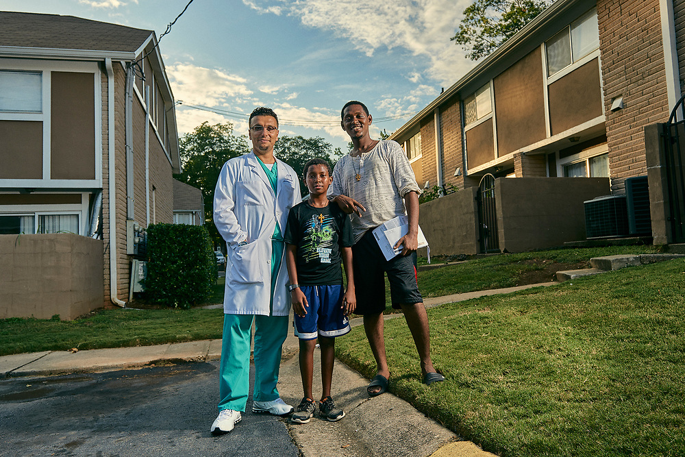 Dr. Heval Kelli, who with his family fled Syria stands with kids at the apartments he lived at in Clarkston, GA when he first came to America. Part of a documentary series on Clarkston, GA.  The most ethnically diverse square mile in America, there are over 70 nationalities that have sought refuge there since the 1980s.
