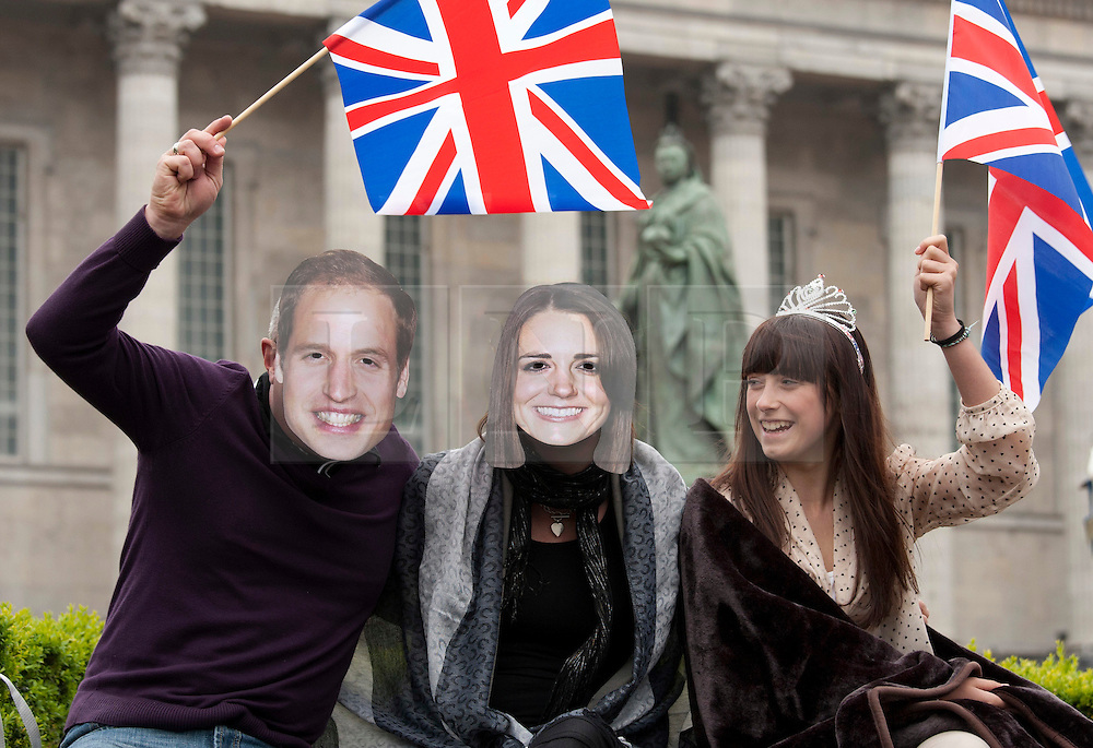 Birmingham, UK  29/04/2011. The Royal Wedding of HRH Prince William to Kate Middleton. People gathered in Victoria Square, Birmingham to watch the Royal Wedding on the big screen, lookalikes under the stare of the Queen Victoria statue. Photo credit should read Dave Warren/LNP. Please see special instructions. © under license to London News Pictures