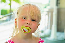 Portrait of little girl with pacifier