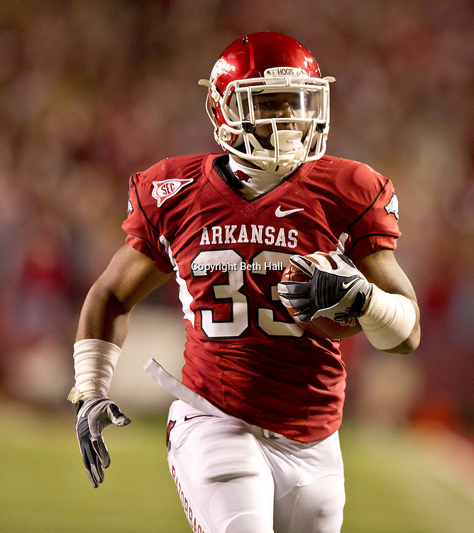 Nov 12, 2011; Fayetteville, AR, USA; Arkansas Razorback running back Dennis Johnson (33) runs the ball for a touchdown against the Tennessee Volunteers during the first half at Donald W. Reynolds Razorback Stadium. Arkansas defeated Tennessee 49-7. Mandatory Credit: Beth Hall-US PRESSWIRE