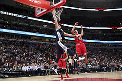March 21, 2018 - Chicago, IL, USA - The Denver Nuggets' Mason Plumlee goes up for a basket over the Chicago Bulls' Cameron Payne (22) during the second half at the United Center in Chicago on Wednesday, March 21, 2018. The Nuggets won, 135-102. (Credit Image: © Armando L. Sanchez/TNS via ZUMA Wire)