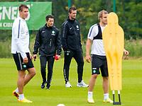 24/06/14<br /> CELTIC TRAINING<br /> LENNOXTOWN<br /> Celtic manager Ronny Deila talks tactics with his new assitant, John Collins (left)