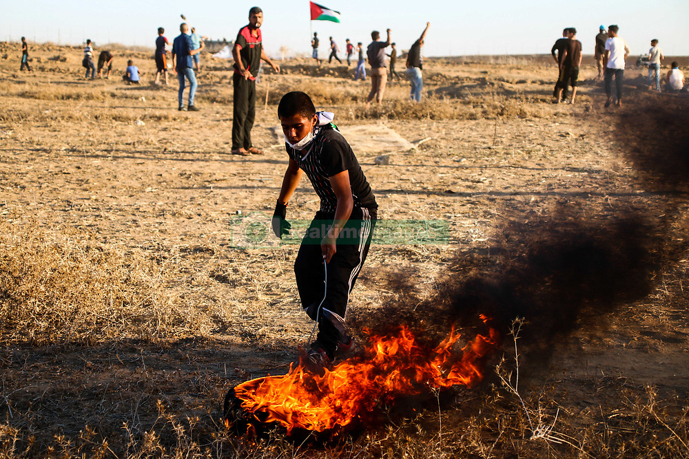 """November 2, 2018 - Palestinian protesters clash with the Israeli army near the fence in the """"Abu Safiya"""" area east of Jabalia in the northern Gaza Strip during the Great March of Return rally on 2th November 2018. Thousands of demonstrators attended several sites along the Gaza border with Israel this Friday, with some advancing and hurling stones towards the fence, and according to the Gaza Health Ministry a number of protesters were injured by Israeli live fire and tear gas. The March has taken place while Egyptian mediators are working to lower tension along the Gaza-Israeli frontier after months of protests and deadly clashes. Since March 2018 thousands of Gaza demonstrators have gathered every Friday along the border in protest against the Israeli siege on Gaza and in support of the right of Palestinian refugees to return the land lost around the founding of Israel in 1948. At least 214 Palestinians have been killed by Israeli fire since the protests started while several thousands have been injured by Israeli live ammunition and tear gas. One Israeli soldier has also been killed since the protests began (Credit Image: © Ahmad Hasaballah/IMAGESLIVE via ZUMA Wire)"""