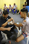 """Gianni Subba, Malaysian MMA hero getting hands bandaged before fighting<br /><br />MMA. Mixed Martial Arts """"Tigers of Asia"""" cage fighting competition. Top professional male and female fighters from across Asia, Russia, Australia, Malaysia, Japan and the Philippines come together to fight. This tournament takes place in front of a ten thousand strong crowd of supporters in Pelaing Stadium. Kuala Lumpur, Malaysia. October 2015"""