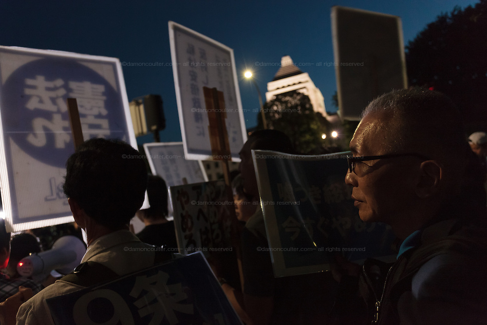 """Teenagers  lead a demo against against the Hawkish administration of Prime Minister, Shinzo Abe, outside the National Diet building in Nagatacho, Tokyo, Japan. Friday June 3rd 2016. Teenagers of the protest group T-nsSOWL called for the right wing Abe to step down and reverse his planned changes to the """"Peace Constitution"""" of Japan which would allow the Japanese armed forces to undertake military activities outside Japan for the first time since the World War 2."""