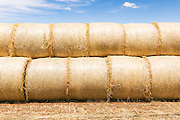 Stack of round hay bales on a farm in rural Kinypanial, Victoria. <br />