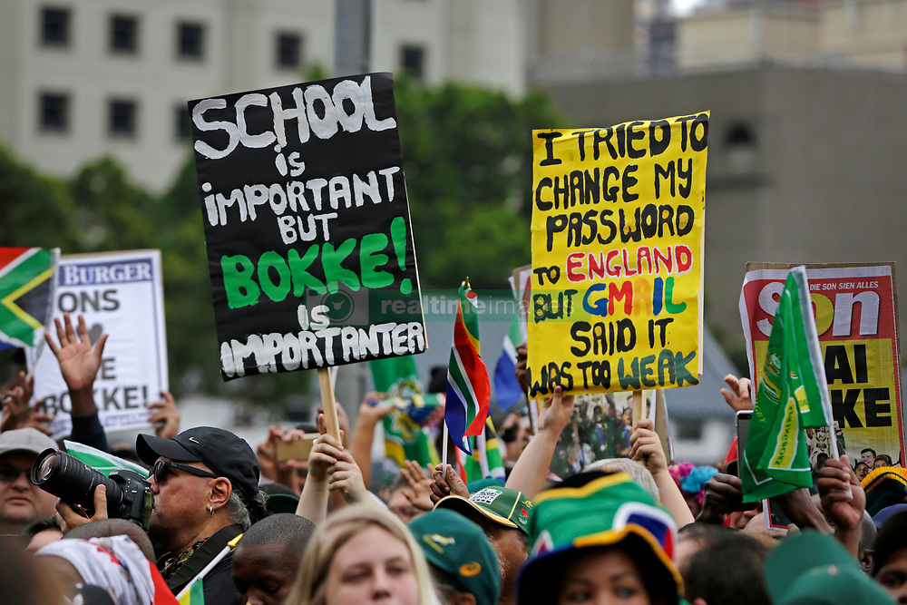 Monday 11th November 2019.<br /> City Hall, Grand Parade,<br /> And City Centre, Cape Town,<br /> Western Cape,<br /> South Africa.<br /> <br /> SPRINGBOKS CELEBRATE WINNING THE RUGBY WORLD CUP CHAMPIONSHIP IN 2019 WITH A COUNTRYWIDE VICTORY TOUR!<br /> <br /> SPRINGBOKS RUGBY WORLD CUP VICTORY TOUR CAPE TOWN!<br /> <br /> Springbok fans holds up posters as they wait along with  thousands of other excited fans on Cape Town's Grand Parade for the Springboks to arrive.<br /> <br /> The reigning Rugby World Cup Champions namely the South African Springbok Rugby Team, celebrates winning the Webb Ellis Cup during the International Rugby Football Board Rugby World Cup Championship held in Japan in 2019 with their Victory Tour that culminated in the final city tour taking place in Cape Town. Thousands of South African fans filled the streets of the city all trying their best to show their support for their beloved Springboks and to celebrate them winning the Rugby World Cup for the third time. South Africa previously won the Rugby World Cup in 1995, 2007 and now again in 2019. South African Springbok Captan Siya Kolisi took the opportunity to speak to the gathered crowd about how something like this brings unity and that we should live together as a nation that practices what is known as ubuntu. Ubuntu is a quality that includes the essential human virtues of compassion and humanity. This image taken in Cape Town on Monday 11th November 2019.<br /> <br /> This image is the property of Seven Bang Media Group (Pty) Ltd, hereinafter referred to as SBM.<br /> <br /> Picture By: SBM / Mark Wessels. (11/11/2019).<br /> +27 (0)61 547 2729<br /> mark@sevenbang.com<br /> www.sevnbang.com<br /> <br /> Copyright © SBM. All Rights Reserved.