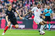 Raheem Sterling (England) wins the ball from Tin Jedvaj (Croatia) during the UEFA Nations League match between England and Croatia at Wembley Stadium, London, England on 18 November 2018.
