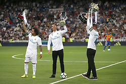 August 27, 2017 - Madrid, Spain - Marcelo, Cristiano Ronaldo and Sergio Ramos with Spain Supercup, Europe Supercup and La Liga trophies. LaLiga Santander matchday 2 between Real Madrid and Valencia. The final score was 2-2, Marco Asensio scored twice for Real Madrid. Carlos Soler and Kondogbia did it for Valencia. Santiago Bernabeu Stadium, august 27, 2017. Photo by  (Credit Image: © |Antonio Pozo |  Media Expre/VW Pics via ZUMA Wire)