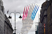 © Licensed to London News Pictures. 10/09/2012. Westminster, UK The Red Arrow display team make flies over The Strand. A flypast over The Strand. British stars of the Olympics and Paralympics celebrate their success with a victory parade through the streets of central London. Photo credit : Stephen Simpson/LNP