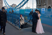 A Chinese couple have their wedding photos taken amid the chaotic repairs to Londons Tower Bridge, on 6th October 2016, in London, England. Closed for repairs to traffic and disrupting this major Thames crossing and surrounding roads for the next three months.