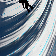 Snowboarding at Cypress Mountain in British Columbia Canada. The shadows from coniferous trees in later afternoon. (Nikon D3 with 400 2.8)