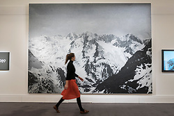 © Licensed to London News Pictures. 22/02/2018. LONDON, UK. A woman walks in front of ''Untitled'' by Rudolf Stingel, (Est. £4,000,000 - 6,000,000) at the preview of Sotheby's upcoming Impressionist, Modern & Surrealist Art auctions taking place at Sotheby's, New Bond Street, on 28 February. Photo credit: Stephen Chung/LNP