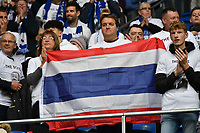 Football - 2018 / 2019 Premier League - Cardiff City vs. Leicester City<br /> <br /> Leicester fans with Thai flag tribute in Leicster's 1st match since the death of Vichai Srivaddhanaprabha, at Cardiff City Stadium.<br /> <br /> COLORSPORT/WINSTON BYNORTH