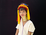 Ma Hui 10, an ethnic Kayan girl from Myanmar at Baan Tong Luang, Eco-Agricultural Hill Tribes Village on 7th June 2016 in Chiang Mai province, Thailand. The fabricated village is home to 8 different hill tribes who make a living from selling their handicrafts and having their photos taken by tourists