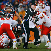 While the rest of the Kansas City Chiefs defense were looking to tackle Denver Broncos running back Selvin Young, left, Chiefs linebacker Derrick Johnson connected on a hit with umpire Jim Quirk in the second quarter on December 9, 2007, at Invesco Field at Mile High Stadium in Denver, CO. The Chiefs lost 41-7.