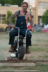 Earl Denton jumping his minibike in the makeshift downtown campground during the Run to Raton. Raton, NM. USA. Saturday July 21, 2018. Photography ©2018 Michael Lichter.