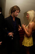Jay Kay and Jodie Oram of U.K. Playboy T.V. , Playboy and Beat celebrate Playboy's 50th anniversary Designer collection. Adam St. club. 19 March 2004. ONE TIME USE ONLY - DO NOT ARCHIVE  © Copyright Photograph by Dafydd Jones 66 Stockwell Park Rd. London SW9 0DA Tel 020 7733 0108 www.dafjones.com