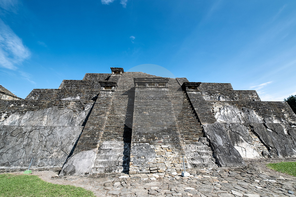 Mesoamerica Blue Temple Pyramid at the pre-Columbian archeological complex of El Tajin in Tajin, Veracruz, Mexico. El Tajín flourished from 600 to 1200 CE and during this time numerous temples, palaces, ballcourts, and pyramids were built by the Totonac people and is one of the largest and most important cities of the Classic era of Mesoamerica.