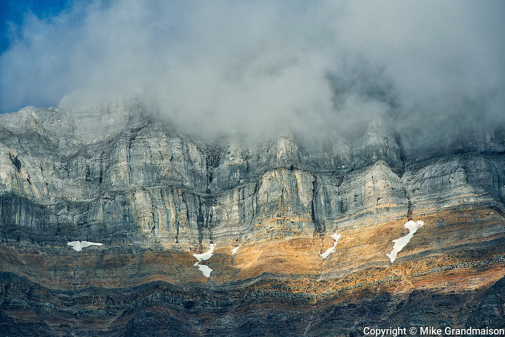 Morning clouds swirling about Mt. Temple northeast of Moraine Lake.<br />Banff National Park<br />Alberta<br />Canada