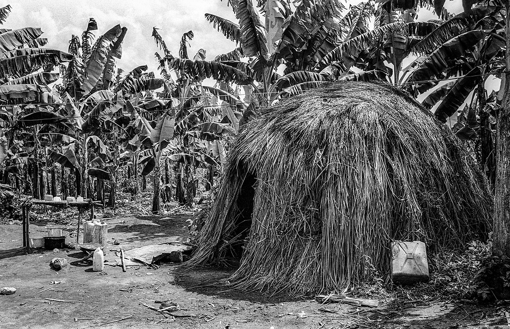 Mud hut, inside a woman dying from Aids. Rural Uganda East Africa